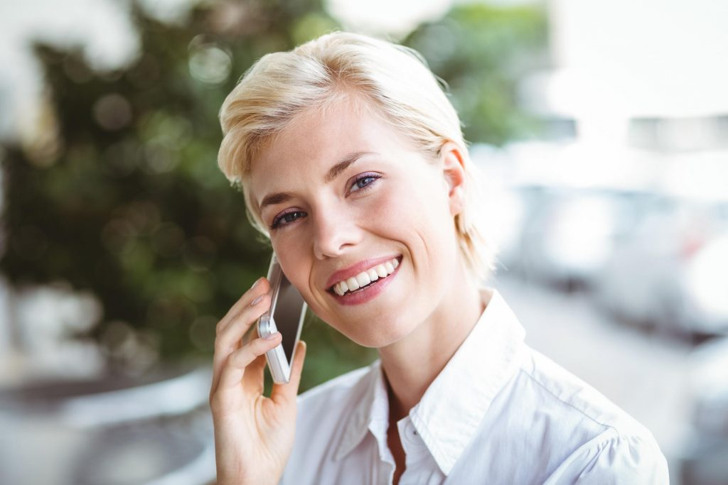 woman under phone call happily